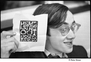 Thumbnail of United States Student Press Association Congress: Raymond Mungo holding sign that reads, 'Help Stamp Out USSPA Nurds'