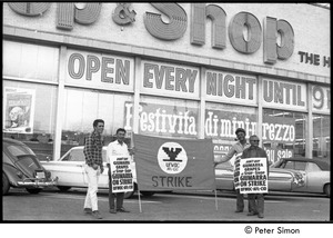 Thumbnail of UFOWC grape pickers strike at Stop and Shop: protestors holding banner and signs with Stop and Shop storefront in background