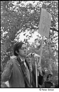 Thumbnail of Resistance rally: Raymond Mungo speaking at rally on Boston Common, man behind holding sign reading 'UMB Veterans against the war'