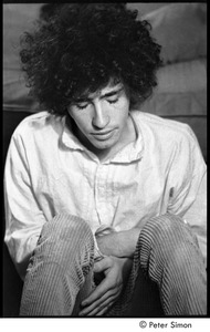 Thumbnail of Tim Buckley at the Catacombs: Buckley backstage, seated on the floor