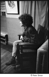Thumbnail of Tim Buckley at the Catacombs: Buckley backstage, seated in a chair