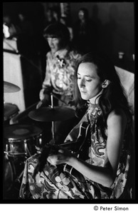 Thumbnail of Unidentified band playing: woman on guitar and man in drums, both dressed in paisley