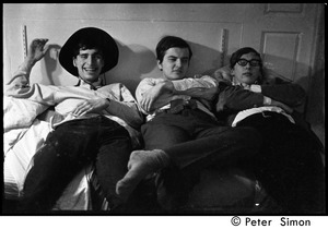 Thumbnail of Boston University News staff members: Stephen Davis, Joe Pilati, and             Clif Garboden (l. to r.) lying on a bed