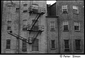 Thumbnail of Fire escapes on the sides of brick buildings