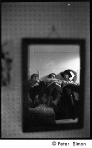 Thumbnail of Boston University News staff: Stephen Davis, Joe Pilati, and Clif Garboden (r.             to l.) reflected in a mirror, lying back