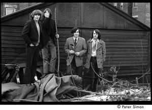 Thumbnail of The  Orphans (Boston rock group): posed in a vacant lot