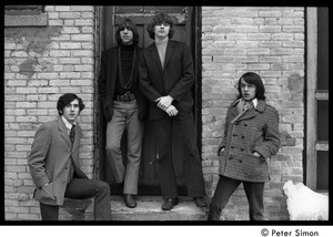 Thumbnail of The  Orphans (Boston rock group): posed at the front of a brick building