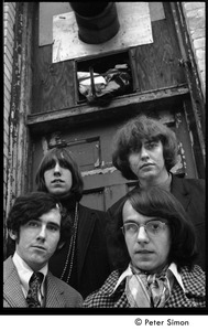 Thumbnail of The  Orphans (Boston rock group): shot from a low-angle of the band