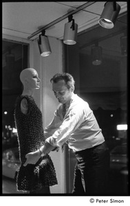 Thumbnail of Jean Levy dressing a mannequin in a window display at Cyreld's boutique,             Coolidge Corner