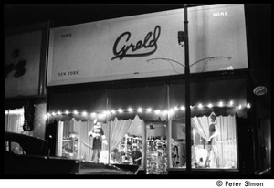 Thumbnail of Front of Cyreld boutique, Coolidge Corner, with window displays lit up at night