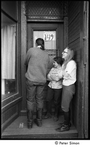 Thumbnail of Three people entering the door at 149 Columbia Street, Cambridge