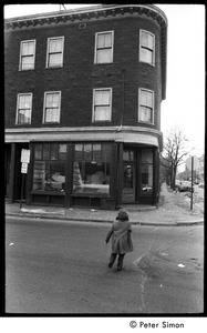 Thumbnail of Young girl crossing Columbia Street, near intersection with Harvard St., Cambridge,             Mass.