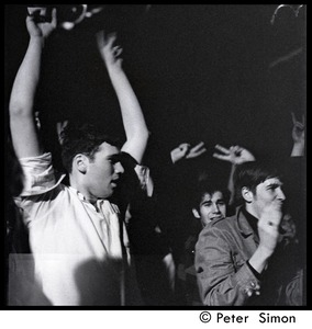 Thumbnail of Spontaneous parade in Boston on hearing that Lyndon Johnson would not pursue a             second term as president: student raising his arms in celebration