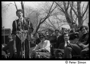 Thumbnail of Resistance on the Boston Common: Staughton Lynd addressing the crowd, Noam             Chomsky (2d from right) and Terry Cannon (far right) on stage
