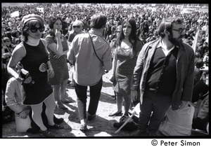Thumbnail of Resistance on the Boston Common: antiwar crowd with Resistance women in             foreground wearing dresses with peace symbol and omega patterns