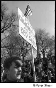 Thumbnail of Resistance on the Boston Common: young counter-protester (Polish Freedom             Fighters Inc.) carrying sign reading 'Fight Communism or die a red slave'