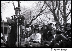 Thumbnail of Resistance on the Boston Common: Staughton Lynd addressing the crowd with Terry             Cannon (far right) and Noam Chomsky (2d from right) seated on stage
