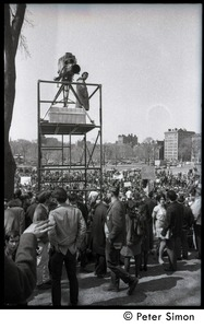 Thumbnail of Resistance on the Boston Common: shot of crowd of antiwar demonstrators and             platform erected for a television camera