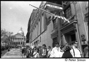 Thumbnail of Marchers commemorating Martin Luther King, Boston Common, proceeding down Park Street, Boston, with State Capitol in background