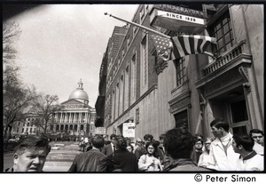 Thumbnail of Marchers commemorating Martin Luther King, Boston Common, proceeding down Park Street, Boston, with State Capitol in background Sign held up by marcher reads 'The King is dead, long live the king'