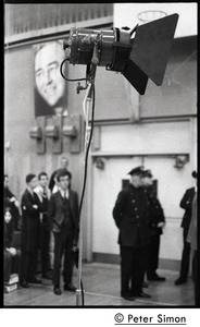 Thumbnail of Lighting stanchion, with police in background, awaiting speech by presidential candidate Eugene McCarthy at Boston             University