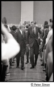 Thumbnail of John Kenneth Galbraith (center right) walking up the aisle             before introducing speech by presidential candidate Eugene McCarthy at Boston University