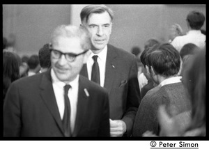 Thumbnail of John Kenneth Galbraith (right) walking up the aisle             before introducing speech by presidential candidate Eugene McCarthy at Boston University