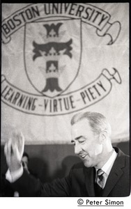 Thumbnail of Presidential candidate Eugene McCarthy on stage, waving to the crowd before speech at Boston University, in front of a large BU banner