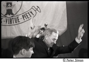 Thumbnail of Presidential candidate Eugene McCarthy waving to the crowd from the stage after speech at Boston University, in front of a large BU banner