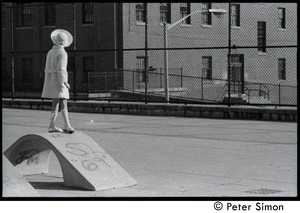 Thumbnail of Young girl in dress clothes standing on playground equipment