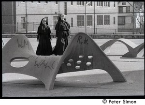Thumbnail of Nuns walking across a playground, on way to commemorative service for Martin             Luther King
