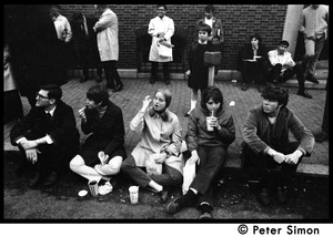 Thumbnail of White student supporters of Umoja (Black student union) activists seated on sidewalk, with onlookers behind, during             occupation of administration building, Boston University