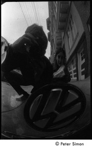 Thumbnail of Peter Simon photographing his reflection (with Verandah Porche) in the hubcap of         a Volkswagen Beetle