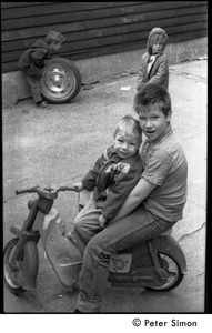 Thumbnail of Children playing with toy moped