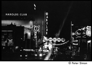 Thumbnail of Lights of Reno at night: neon signs for Harold's Club, Harrah's, and 'Reno: the             biggest little city in the world'