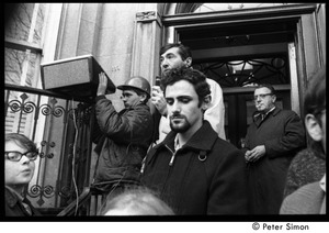 Thumbnail of Howard Zinn at the entrance to the University Placement Office,             Boston University, addressing protesters demonstrating on-campus recruiting by Dow Chemical Co.