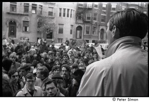 Thumbnail of View over Howard Zinn's shoulder of protesters outside the University Placement Office,             Boston University, demonstrating on-campus recruiting by Dow Chemical Co.