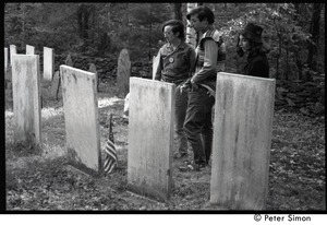 Thumbnail of Raymond Mungo, Marty Jezer, and Michelle Clarke (l. to r.) looking at             gravestones in a cemetery