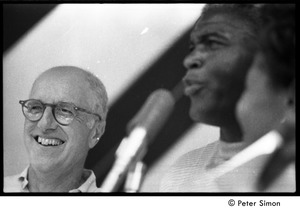 Thumbnail of Jackie Robinson at the microphone standing next to George T. Simon