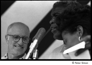 Thumbnail of Jackie Robinson at the microphone standing next to an George T. Simon