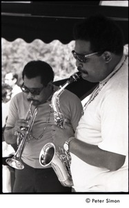 Thumbnail of Cannonball Adderley (sax) and Nat Adderley (cornet), with the Cannonball Adderley Sextet, performing at Jackie Robinson's jazz concert