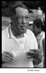 Thumbnail of Duke Ellington eating a popsicle at Jackie Robinson's jazz concert
