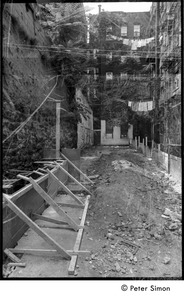 Thumbnail of Double exposure of inner city alley way and construction