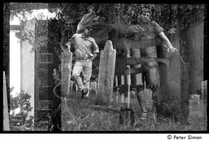 Thumbnail of Double exposure of Kim Rosen and Harvey Wasserman (l. to r.) in a graveyard, Packer             Corners commune