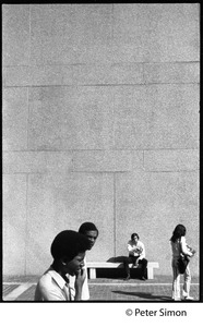 Thumbnail of Students walking in front of a concrete wall, Boston University
