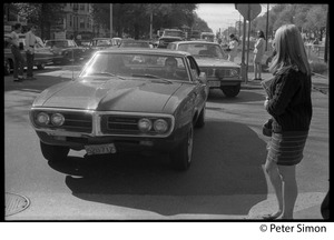 Thumbnail of Student waiting as a Pontiac Firebird drives by, Boston University