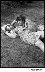 Thumbnail of Peter Simon and woman lolling on the lawn