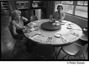 Thumbnail of Two women seated at a table in the empty dining room during the one-day strike at Shelton Hall, Boston             University