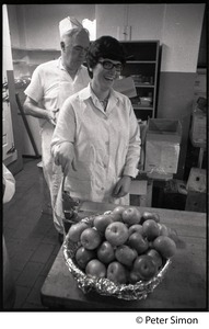 Thumbnail of Cafeteria workers with bowl of apples at Shelton Hall, Boston University