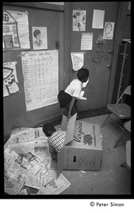 Thumbnail of Students playing in a box, the Liberation School
